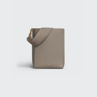 Celine's small Sangle bucket bag in color Taupe.