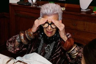 Iris Apfel covering up her eyes