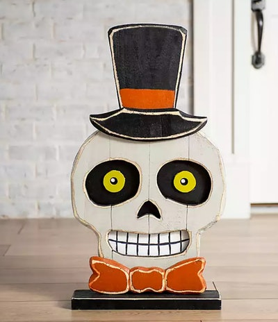 Skeleton head in top hat with bow tie; table decor