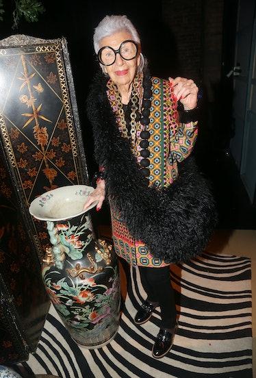 Iris Apfel touching a large vase