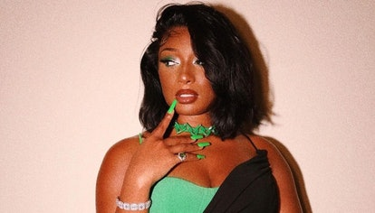 Megan Thee Stallion with long green nails