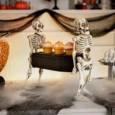 Two skeletons carrying a casket; miniature size, cupcakes on the casket