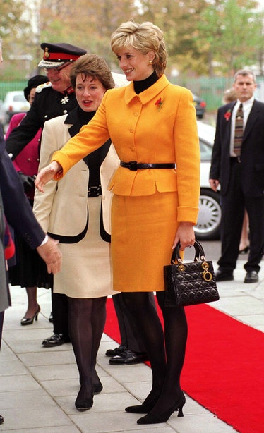 Princess Diana Visiting Liverpool. Diana Is Wearing A Bright Orange Suit Designed By Versace And She...