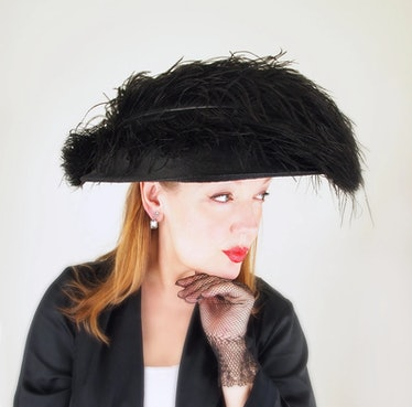 wide brim feathered hat