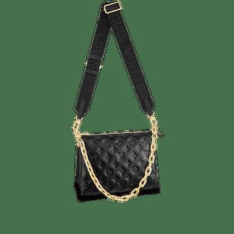 Black monogram-embossed lambskin Coussin PM crossbody bag from Louis Vuitton.