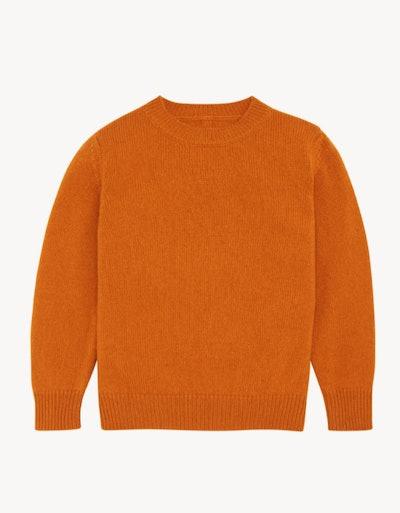 Flay lay of orange crew neck sweater