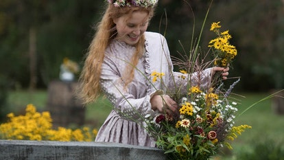 Beth march carries picked flowers in a Little Women scene bursting with cottagecore aesthetic vibes