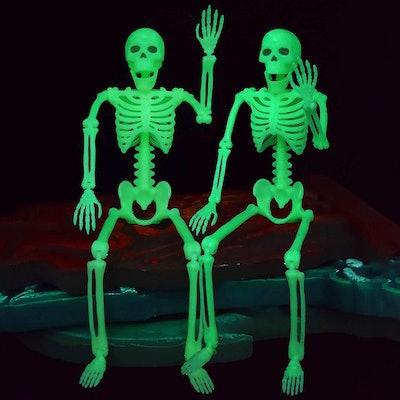 Two glow in the dark skeletons