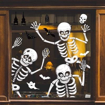 Halloween decorations; three skeleton window clings