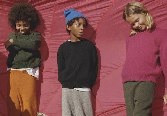 Three kids standing, modeling The Row kids line