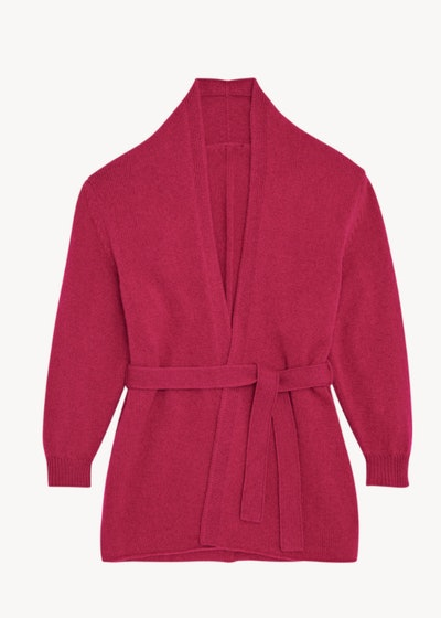 Flay lay of a fuchsia belted cardigan