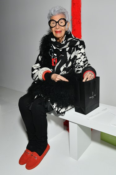 Iris Apfel wearing red shoes at a Calvin Klein show