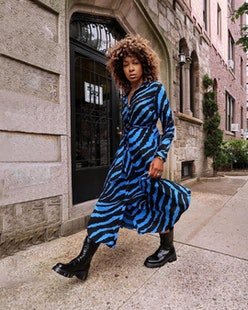 Karen Blanchard wearing a zebra dress and black combat boots.