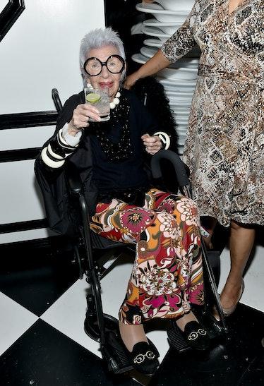 Iris Apfel raising a glass