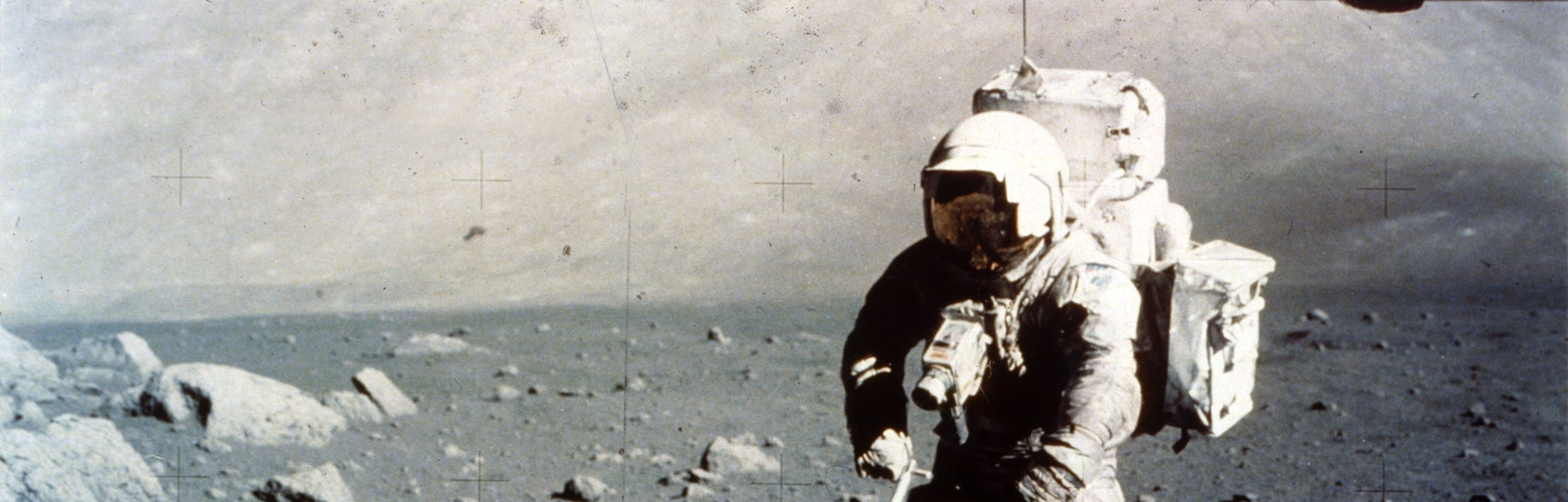 Harrison Schmitt works the scoop on the lunar surface, Apollo 17 mission