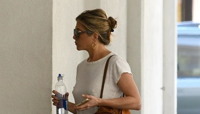 Actor Jennifer Aniston wears Chloé Faye backpack in Tan while out and about in Beverly Hills, Los An...