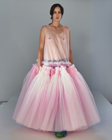 A model poses for Molly Goddard's SS22 collection in a maxi pink tulle dress.