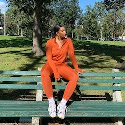 Influencer and YouTuber Tyla Lauren wears terra cota All Access Unison ¼ Zip and Center Stage Leggin...