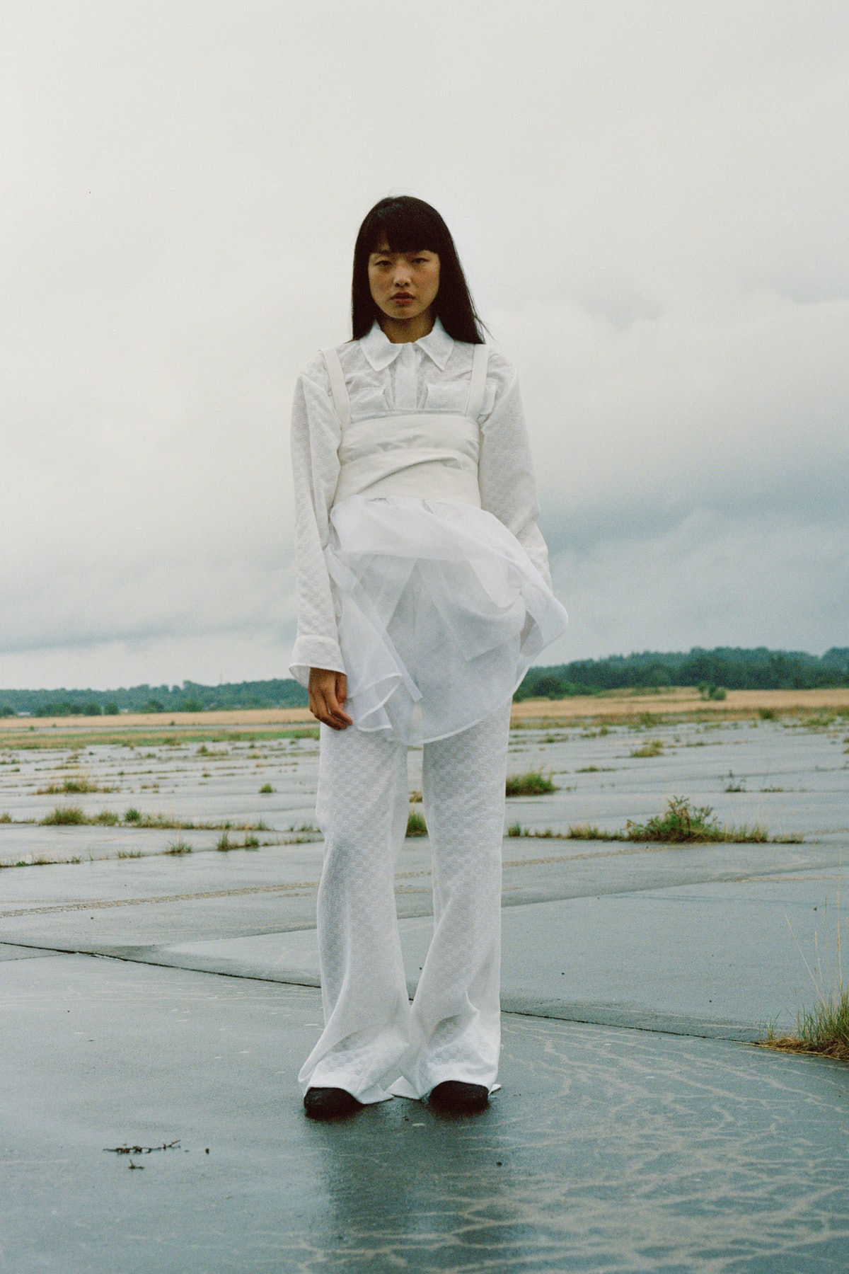 model in white Cecilie Bahnsen shirt and pants
