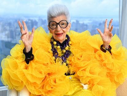 Iris Apfel wearing a dramatic yellow look