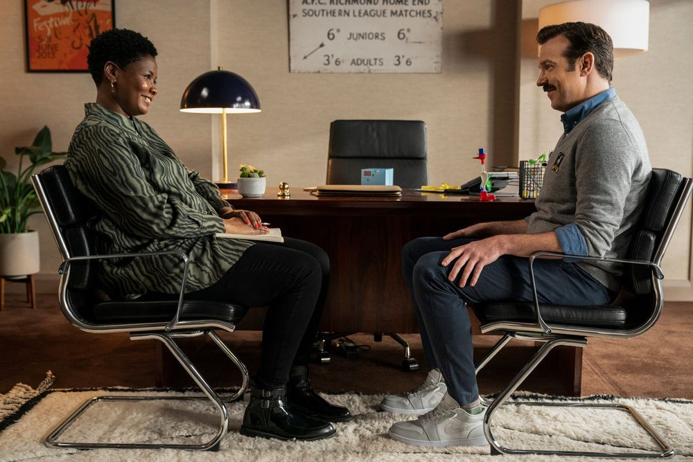 Ted Lasso reluctantly sits down with Dr. Sharon for a therapy session.