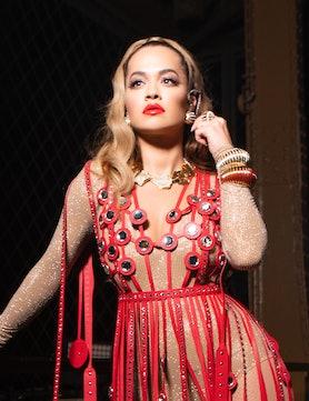Rita Ora wearing a custom red dress and red lip