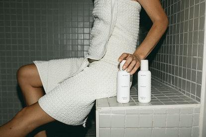REVERIE model holding bottles in shower