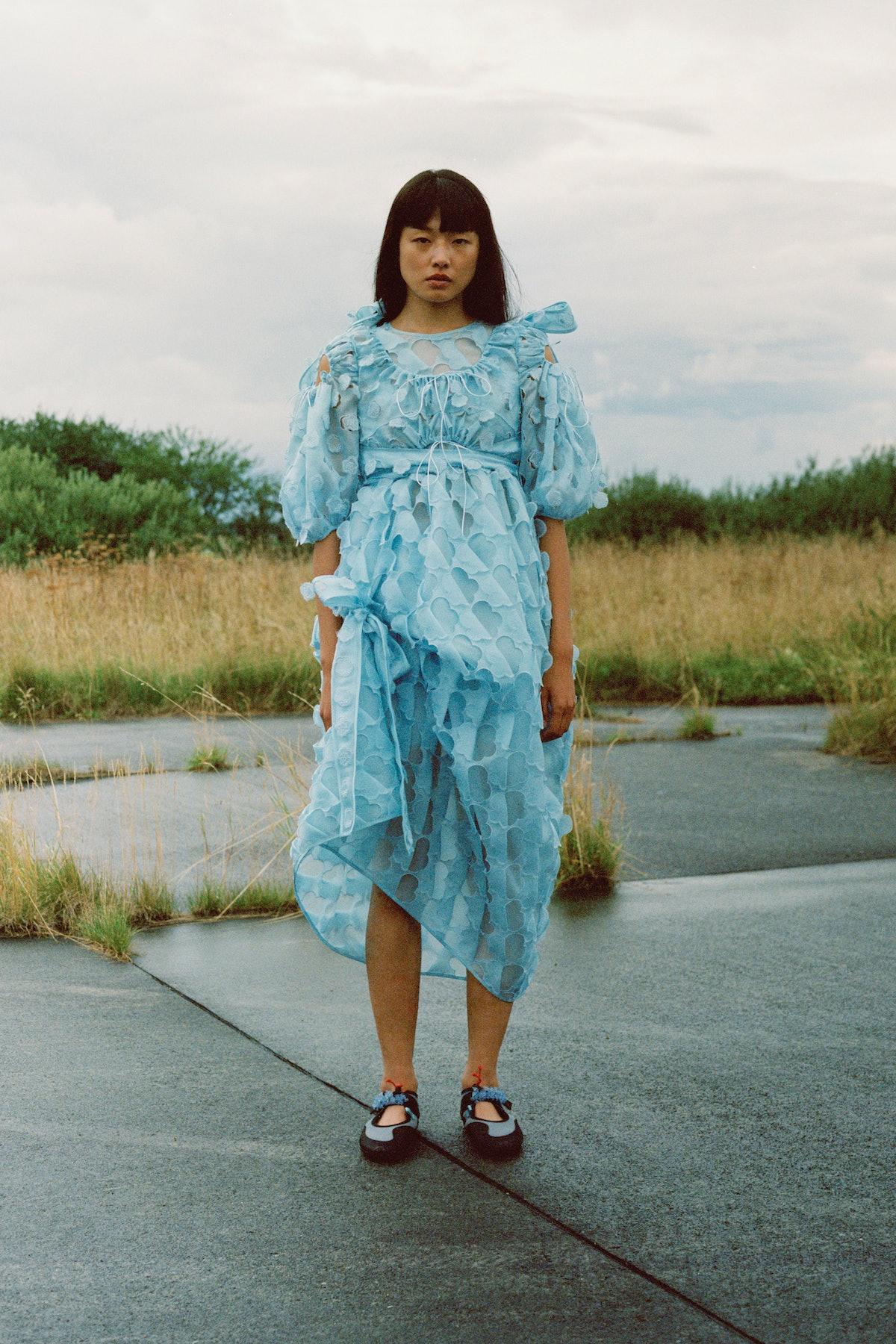 Model in blue cecilie bahnsen dress