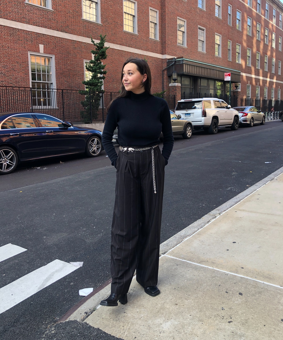 Emma Childs wears a black sweater and pinstripe trouser from Nili Lotan x Target.