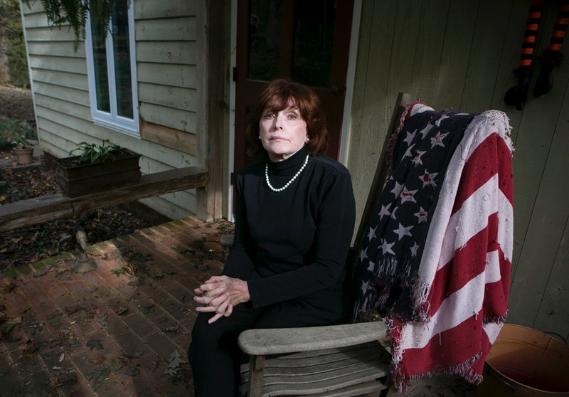 Kathleen Willey, 72, sits on the front porch at her home in Powhatan, Va.