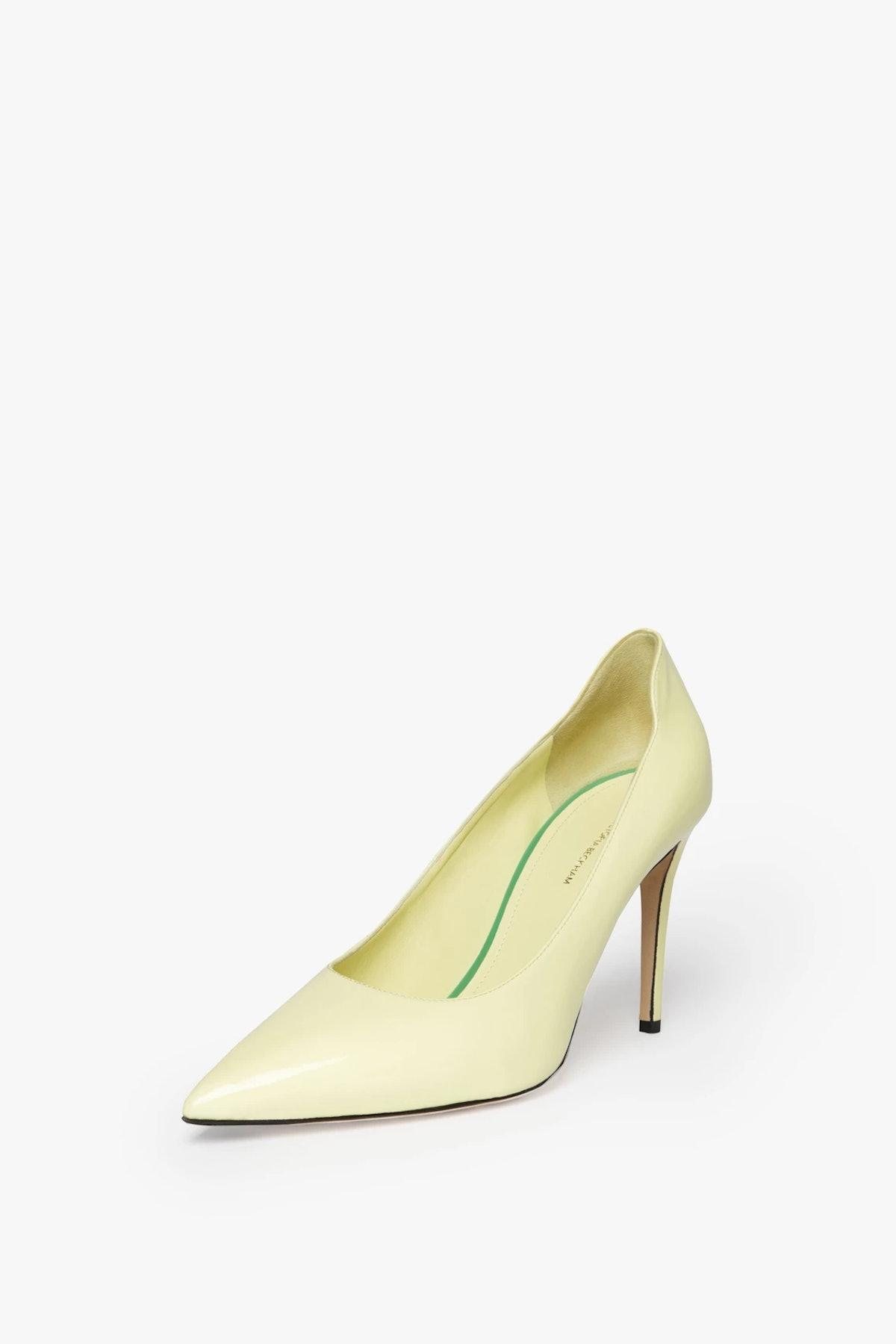 Victoria Beckham's pale yellow pumps.