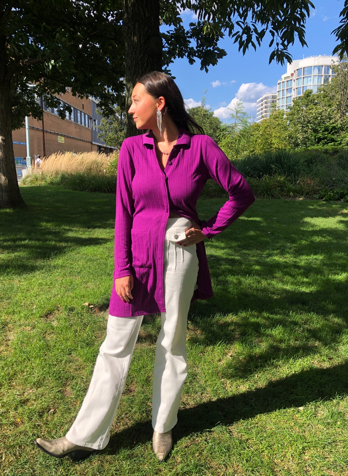 Emma Childs wears a purple sweater and white trousers from Victor Glemaud x Target.