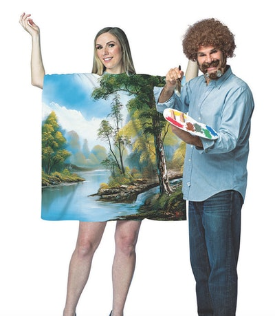 Man dressed as Bob Ross with woman dressed as a painting.