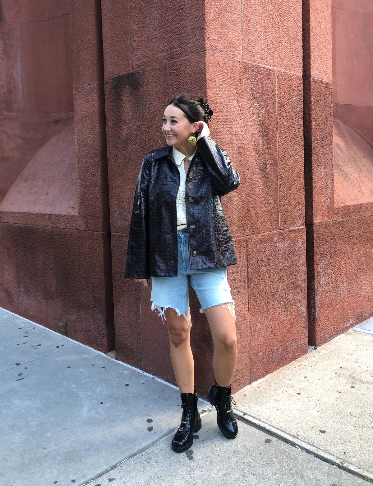 Emma Childs wears a sweater, jacket, and earrings from Rachel Comey x Target.