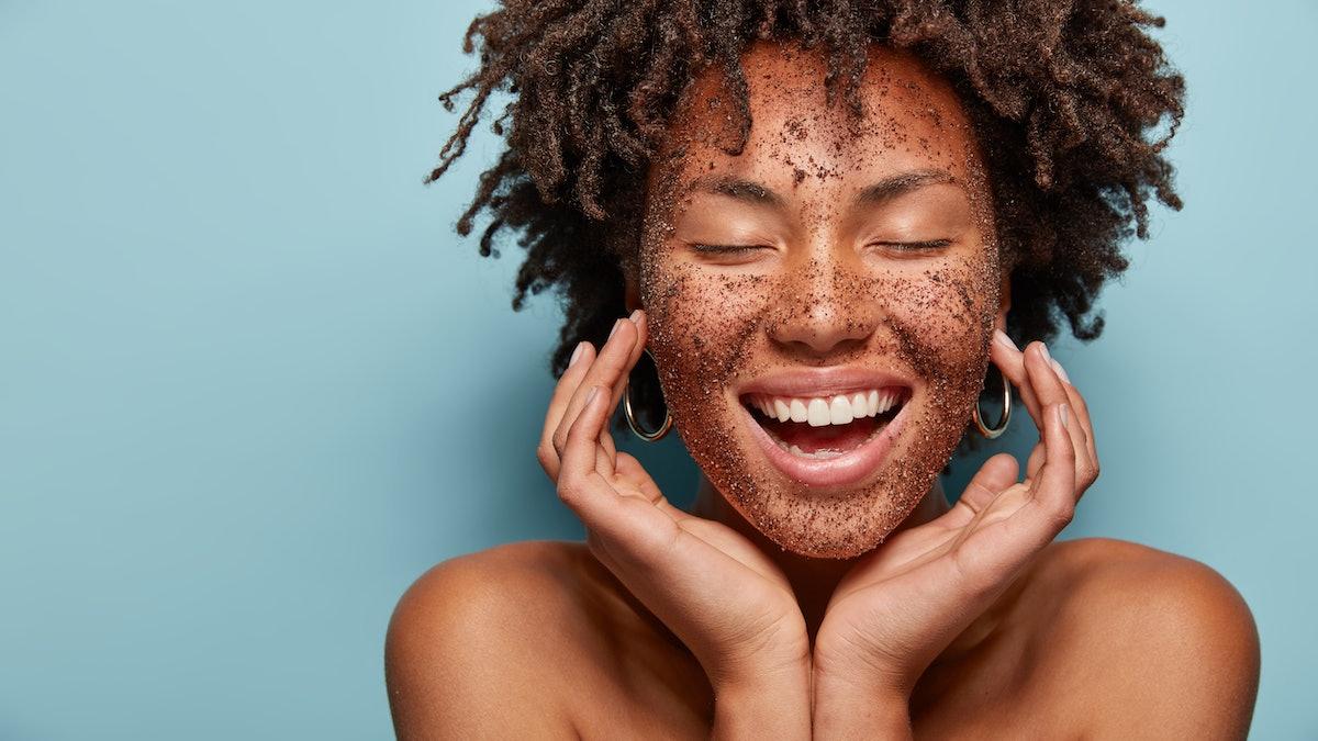 Woman washing face with scrub