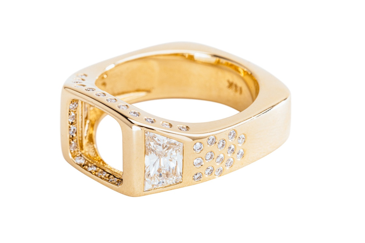 Open signet engagement ring by Made by Malyia.