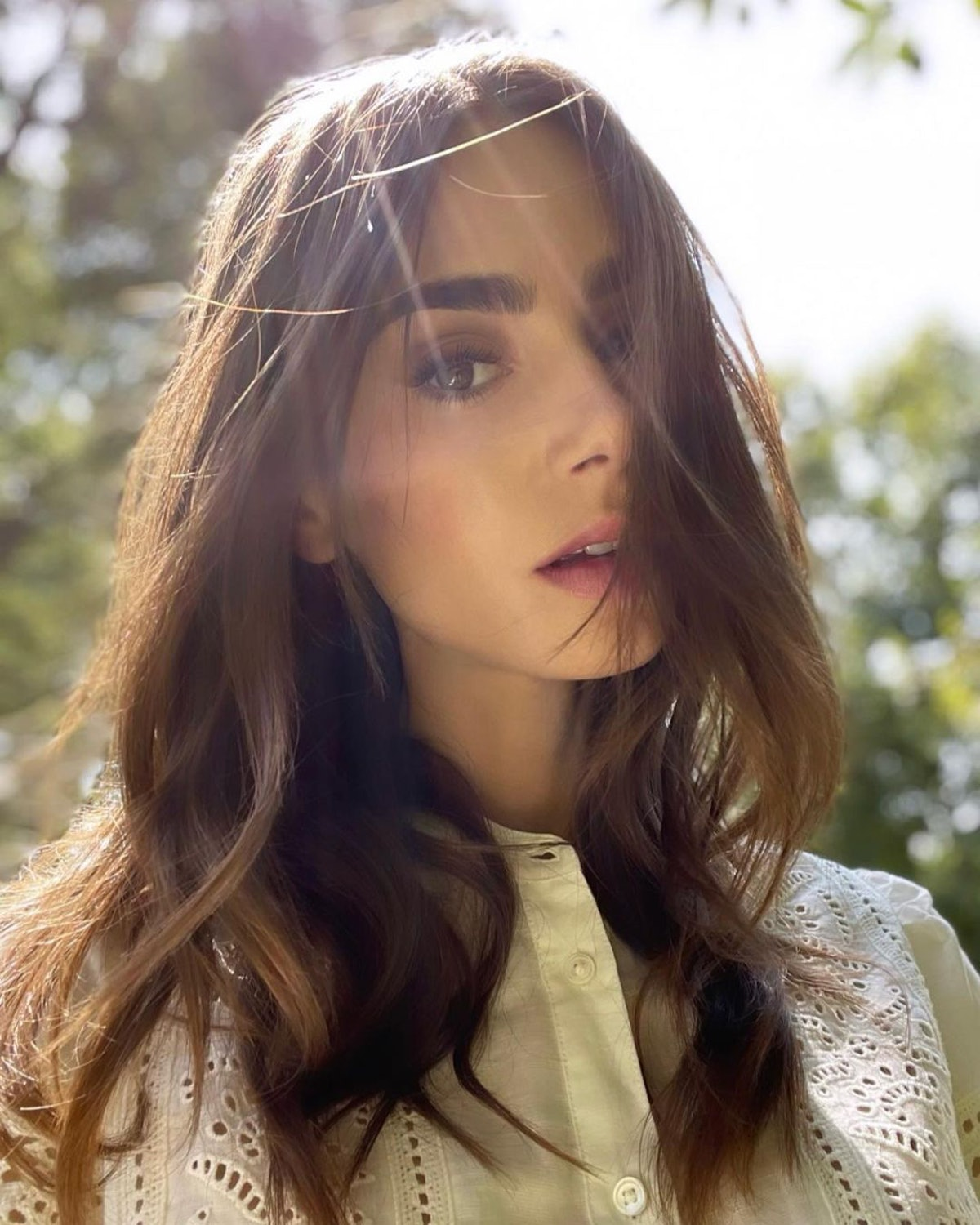Lily Collins poses in a selfie.