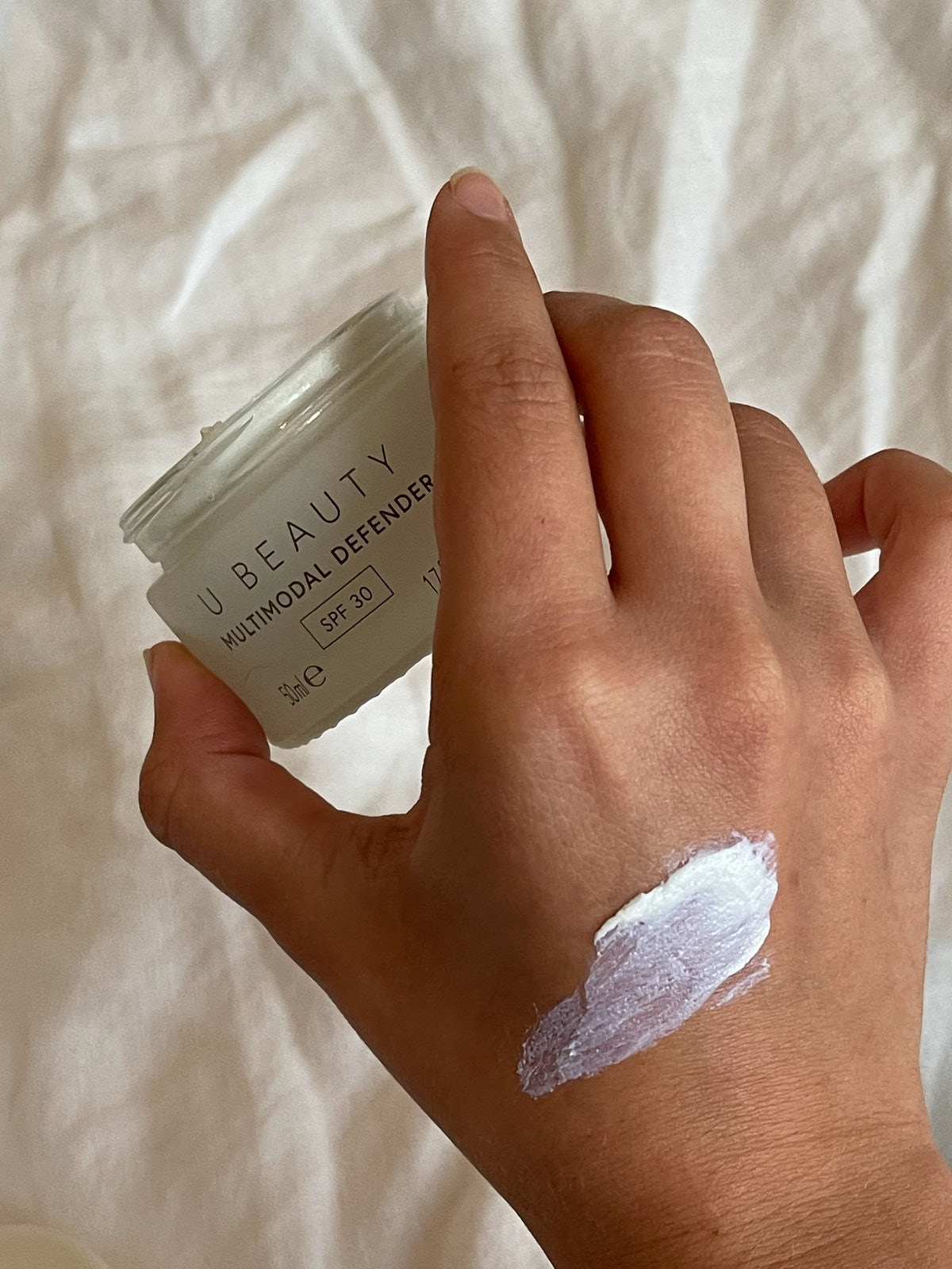 The sunscreen swatched on Isabella's hand