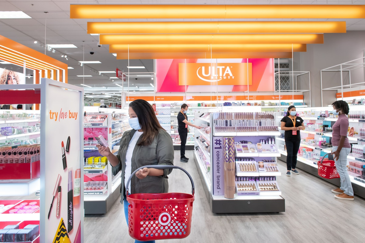 Shoppers and associates shop for beauty products from Ulta Beauty at Target