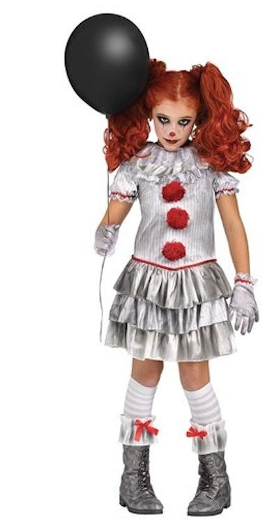 Girl wearing a creepy clown Halloween costume