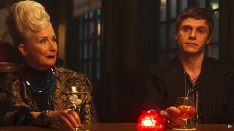 Belle and Austin in the town bar with a red candle in 'American Horror Story: Double Feature'