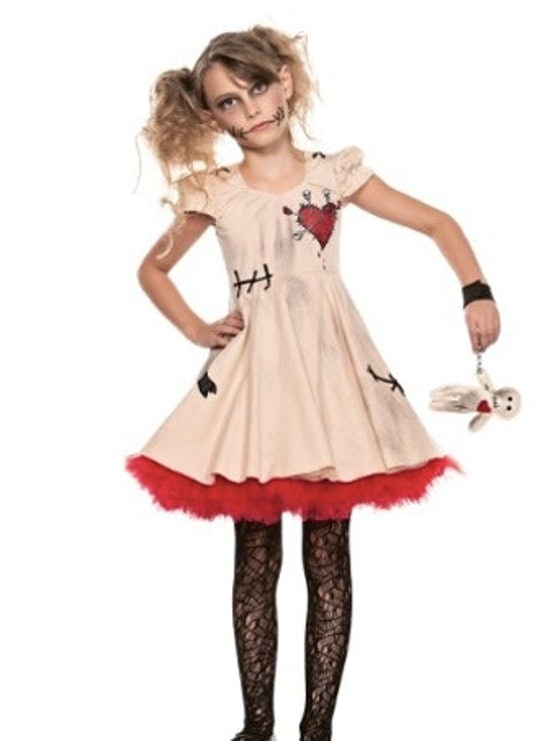girl in creepy doll halloween costume