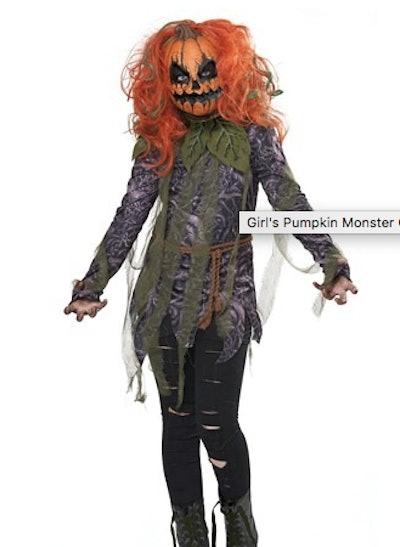 Child dressed as a pumpkin monster