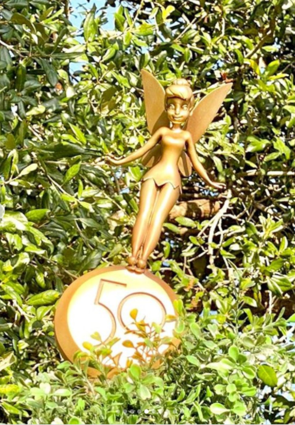 These photos of Disney's gold statutes for the 50th anniversary include Tinkerbell.