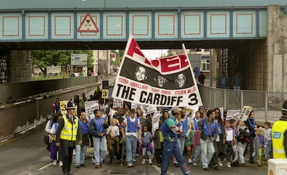A protest march leaves Butetown on its way to Cardiff prison.