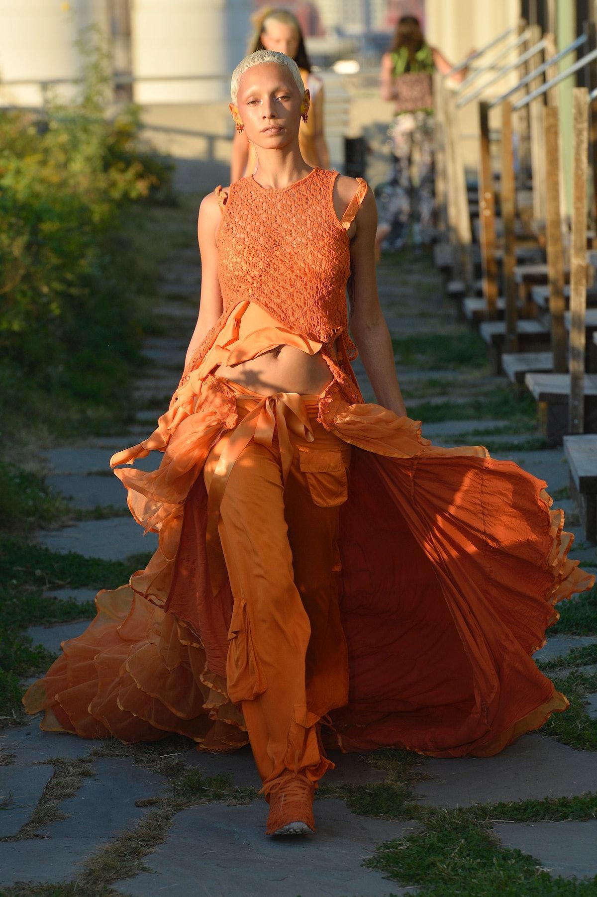 A model walks the runway at Collina Strada Spring/Summer 2022 at Brooklyn Grange Rooftop during New ...