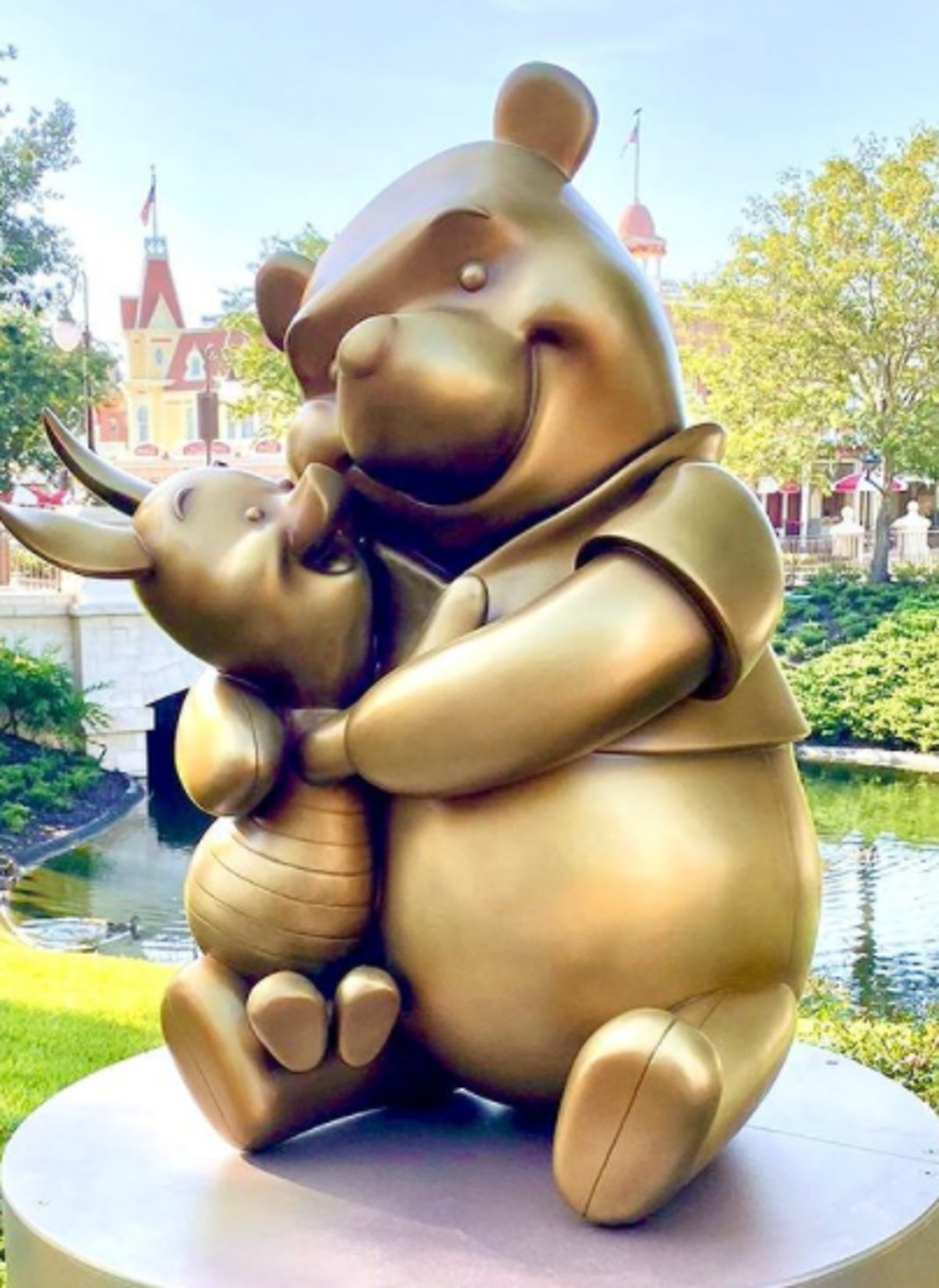 These photos of Disney's gold statues for the 50th anniversary feature one of Winnie the Pooh and Pi...