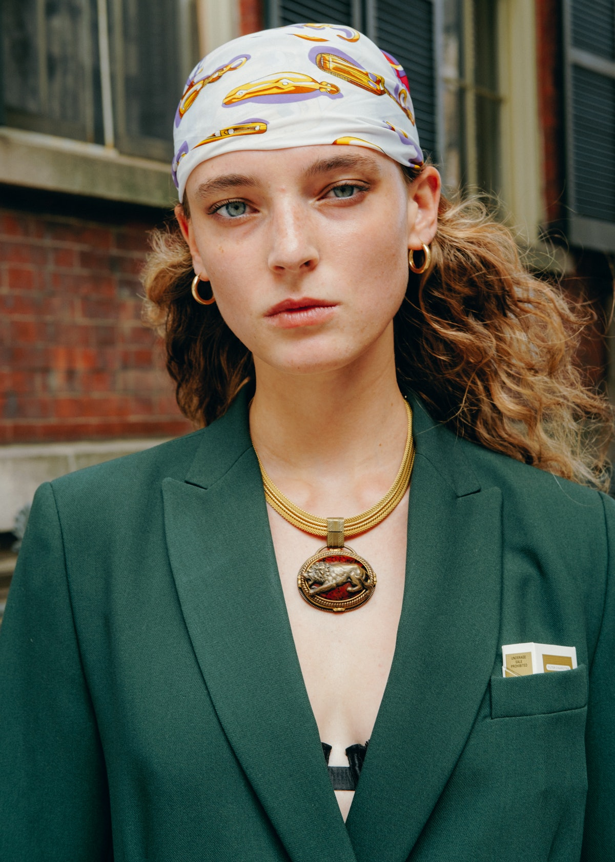 Portrait of young girl on the street.  Wear a green blazer.