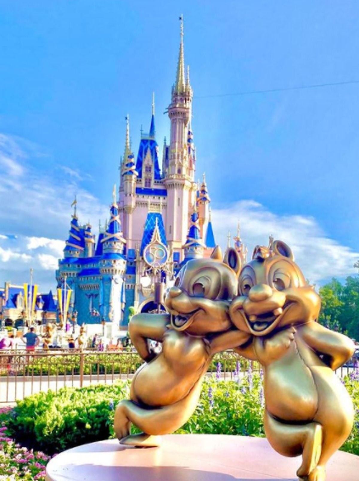 These photos of Disney's gold statues for the 50th anniversary include an adorable Chip and Dale.