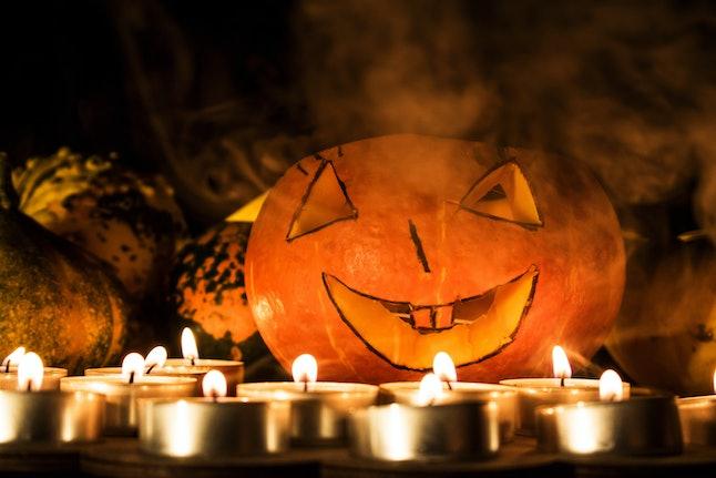Halloween pumpkin in smoke. Smiling pumpkin for Halloween.